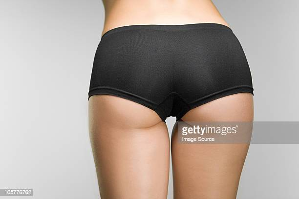 woman wearing knickers - woman bum stock photos and pictures