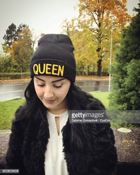 Woman Wearing Knit Hat With Text