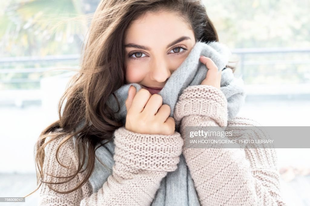 Woman wearing knitted sweater and scarf : Stock Photo