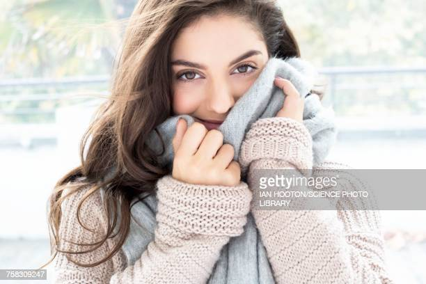 woman wearing knitted sweater and scarf - schal stock-fotos und bilder