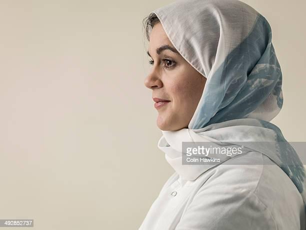 Woman wearing laboratory coat and hijab head scarf