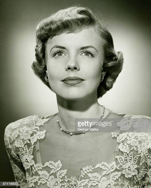 Woman wearing lace dress posing in studio, (B&W), (Close-up), (Portrait)