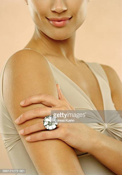Woman wearing large diamond ring, close up