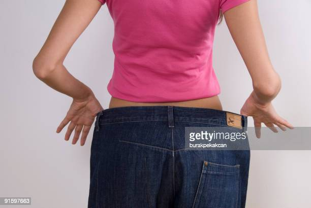 Woman wearing large jeans, diet