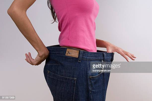 Woman wearing large jeans