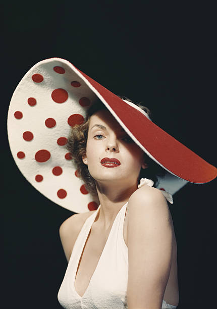 Woman wearing large spotted hat, portrait