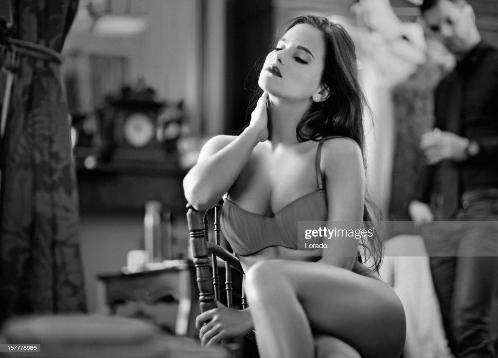 woman wearing lingerie posing indoors : Stock Photo
