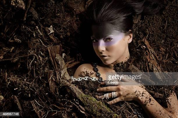 woman wearing luxury jewellery laying down in dirt
