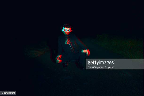 woman wearing mask at night - illusion stock pictures, royalty-free photos & images
