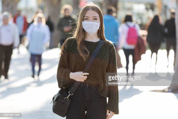 woman wearing mask to avoid infectious diseases - face masks imagens e fotografias de stock