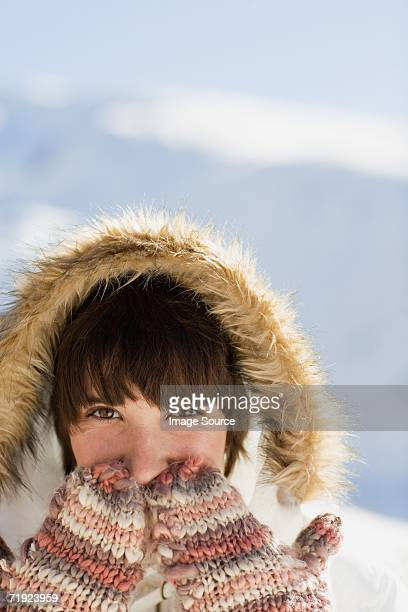 Woman wearing mittens