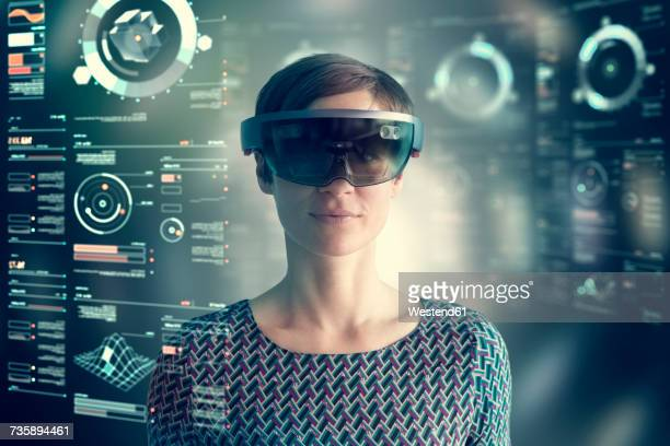 Woman wearing mixed reality smartglasses at transparent screen