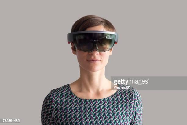 Woman wearing mixed reality smartglasses