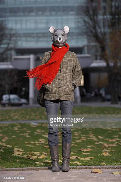 Woman wearing mouse mask outdoors