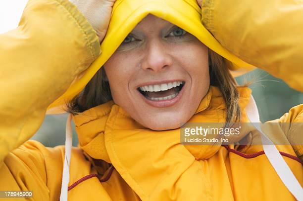 Woman wearing nautical rain gear