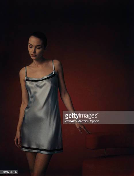 woman wearing nightgown, looking down, portrait - women in slips stock photos and pictures