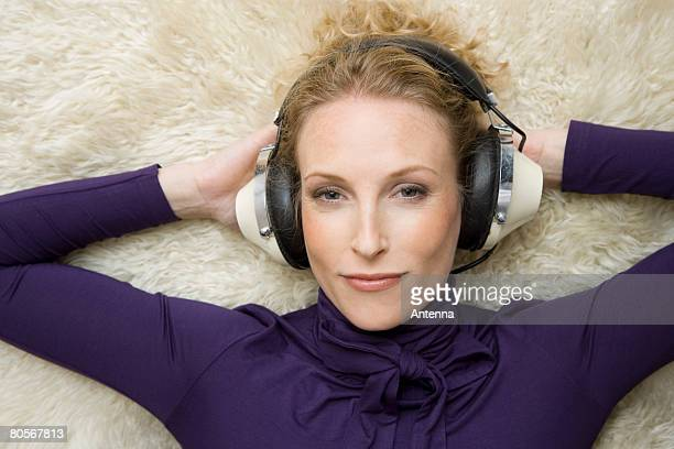 A woman wearing old-fashioned headphones