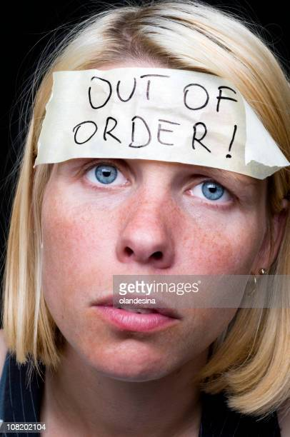Woman Wearing Out of Order Sticker on Head