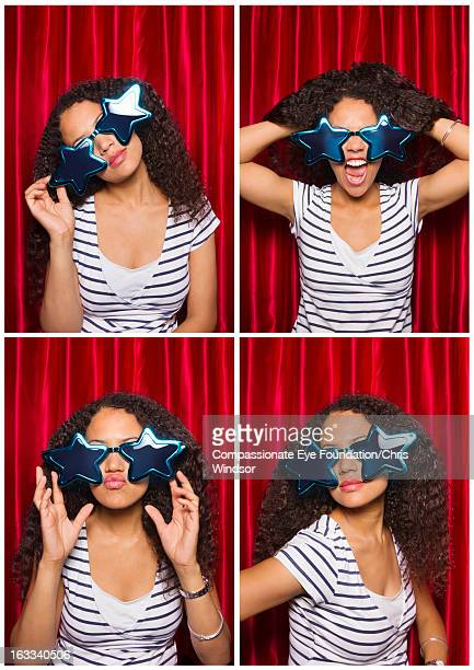 Woman wearing oversized sunglasses in photo booth