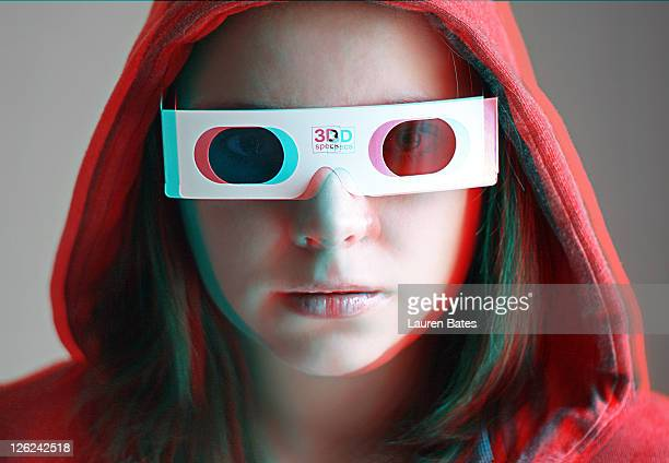 woman wearing pair of red/blue 3d glasses