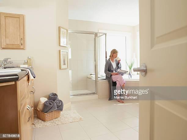 Woman wearing pajamas in bathroom
