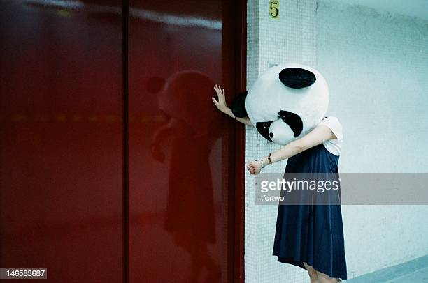 woman wearing panda mask - panda animal stock photos and pictures