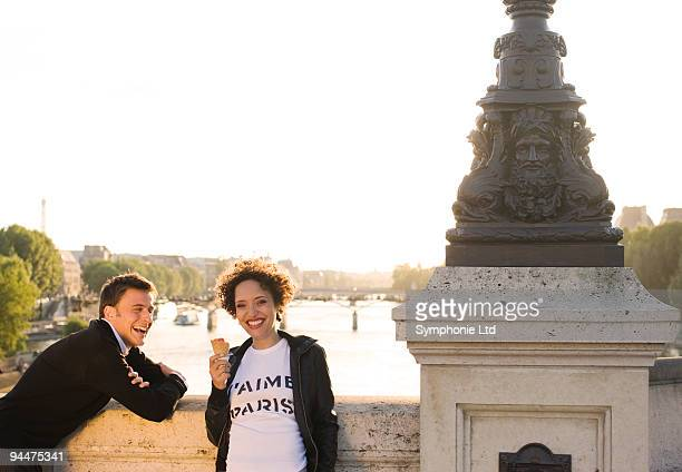 Woman wearing �Paris J�aime� t-shirt on bridge