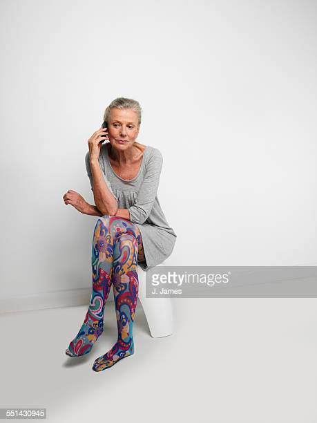 woman wearing patterned stockings - old women in pantyhose stock photos and pictures