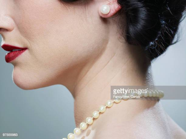 woman wearing pearl necklace and earring - pearl necklace stock pictures, royalty-free photos & images