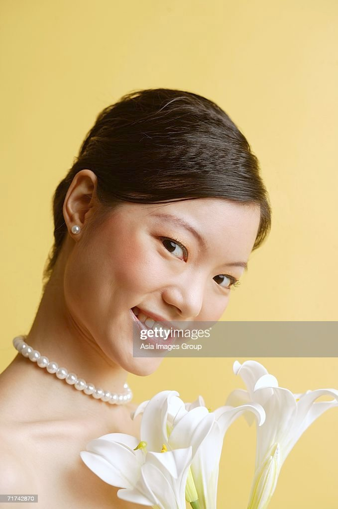 Asian girl pearl necklace