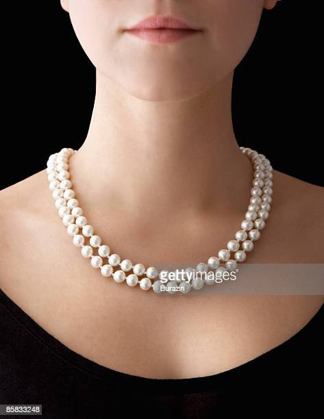woman wearing pearl necklace - necklace stock pictures, royalty-free photos & images