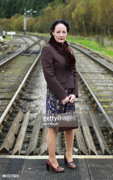 A woman wearing period 1940's clothing poses on a railway crossing during the North Yorkshire Moors Railway 1940's Wartime Weekend event on October...