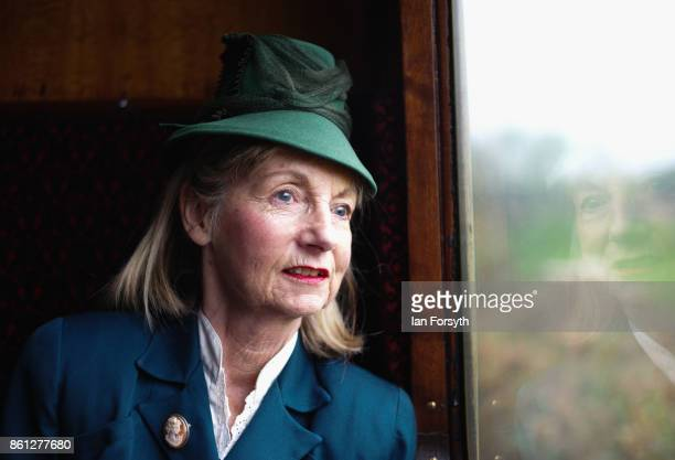 A woman wearing period clothing looks out of her carriage window as she travels to Pickering during the North Yorkshire Moors Railway 1940's Wartime...