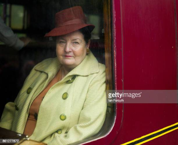 A woman wearing period clothing looks out of the window of her carriage during the North Yorkshire Moors Railway 1940's Wartime Weekend event on...