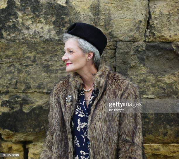 A woman wearing period clothing waits for friends during the North Yorkshire Moors Railway 1940's Wartime Weekend event on October 14 2017 in...