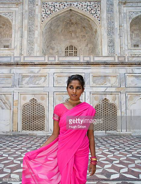 woman wearing pink sari - hugh sitton stockfoto's en -beelden
