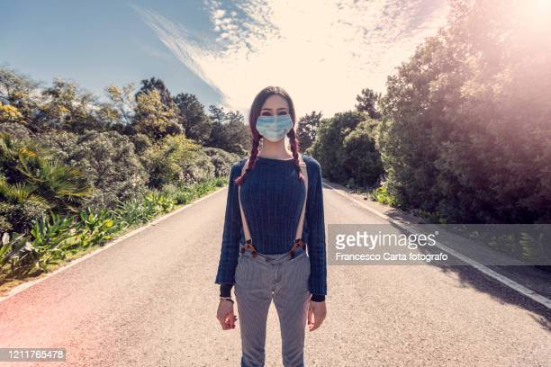 woman wearing pollution mask - italy coronavirus stock pictures, royalty-free photos & images