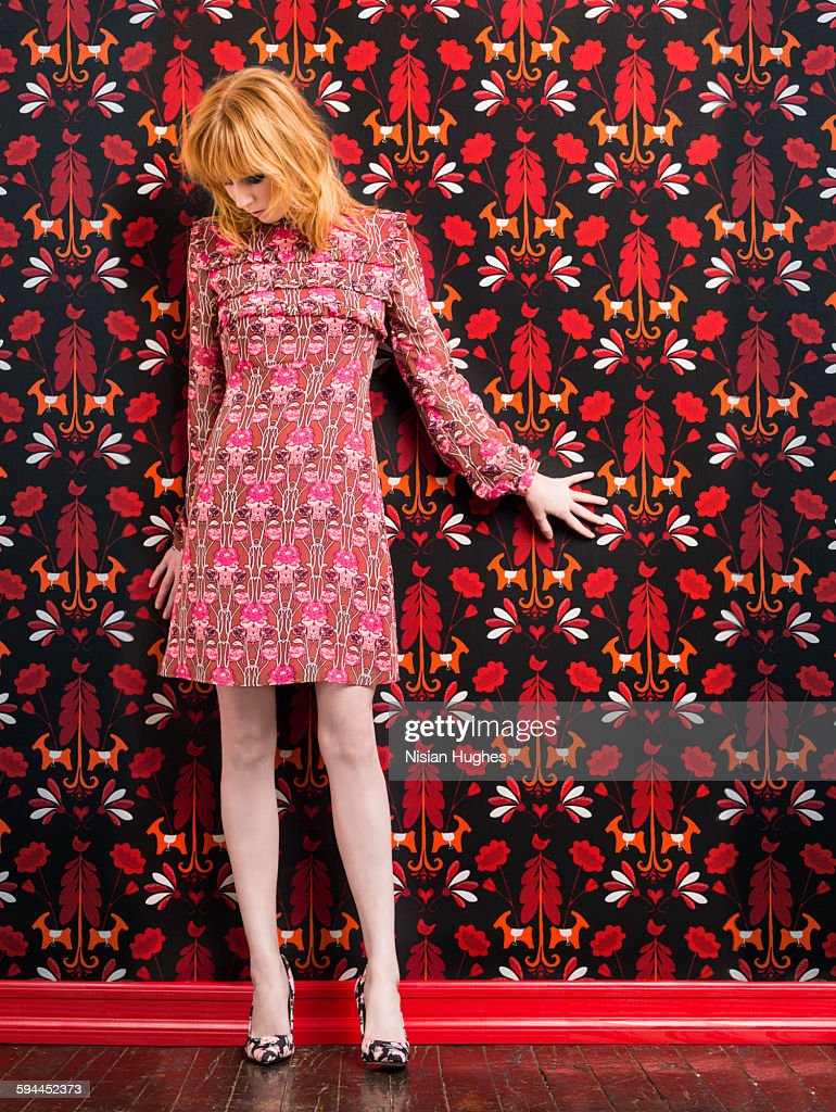 Woman wearing print dress against print background : Stock Photo
