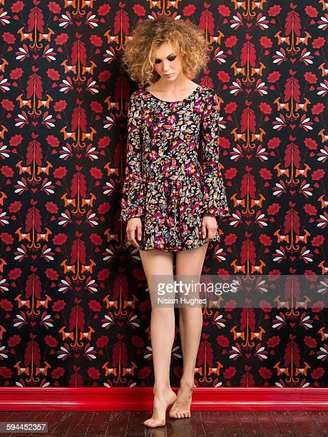 woman wearing print dress on print background