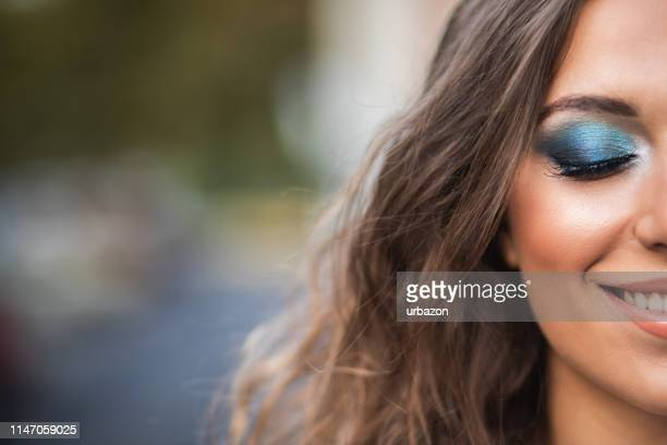 woman wearing professional make-up - eyeshadow stock pictures, royalty-free photos & images