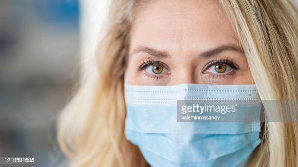 woman wearing protective face mask in the office for safety and protection during covid-19 - world health organization stock pictures, royalty-free photos & images