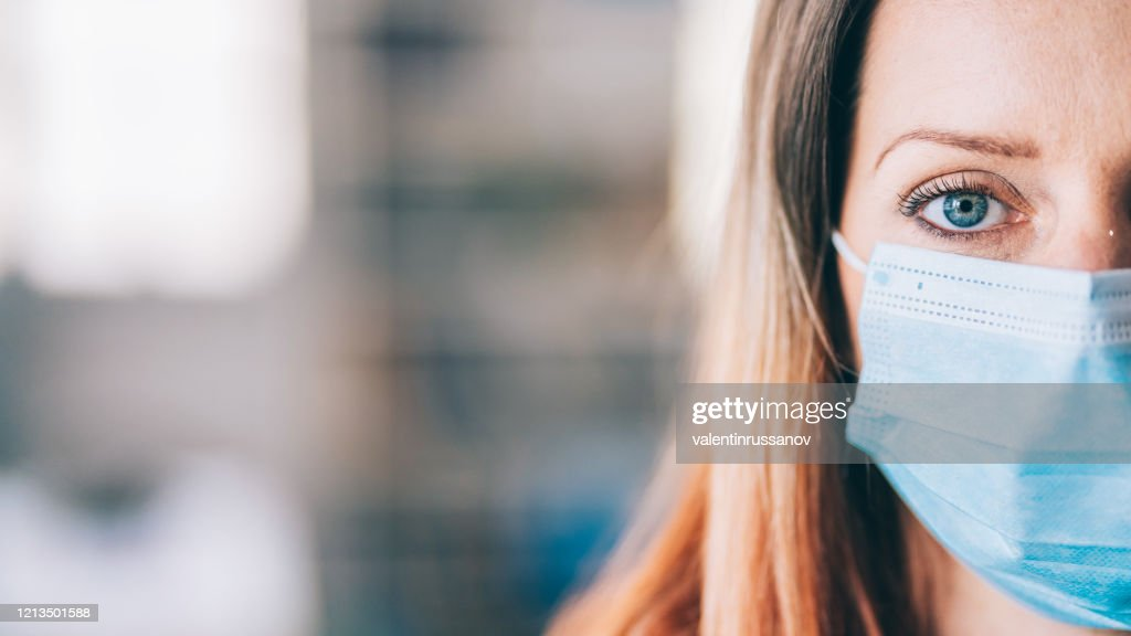 Woman wearing protective face mask in the office for safety and protection during COVID-19 : Stock Photo