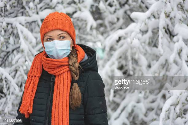 woman wearing protective mask. new coronavirus covid-19 from china - coronavirus winter stock pictures, royalty-free photos & images