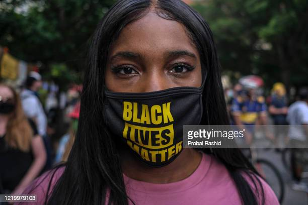 Woman wearing protective mask with Black Lives Matter written on it near the White House while protesting against police brutality and racism. This...