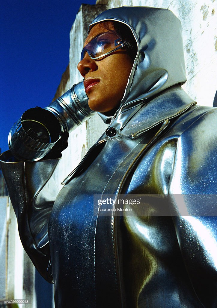 Woman wearing protective suit, low angle view : Stockfoto