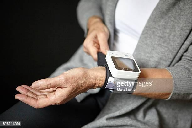 Woman wearing pulse watch