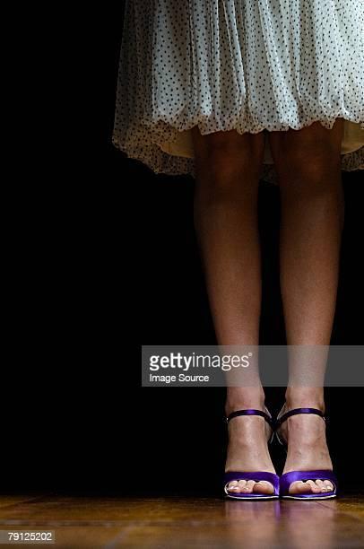 Woman wearing purple high heeled shoes