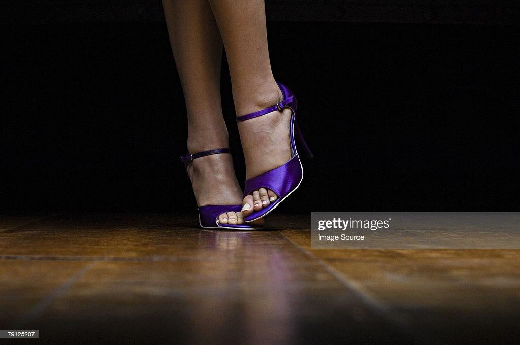 Woman wearing purple high heeled shoes : Stock Photo