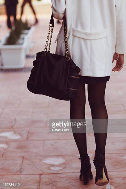 Woman wearing purse, panties and high heels
