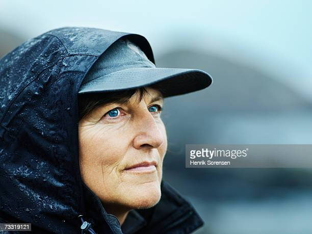 Woman wearing rain jacket and hat